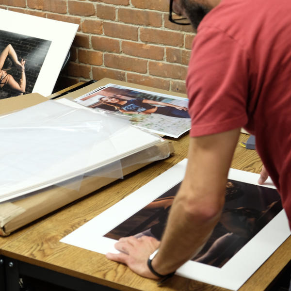 Artist mounting photographs
